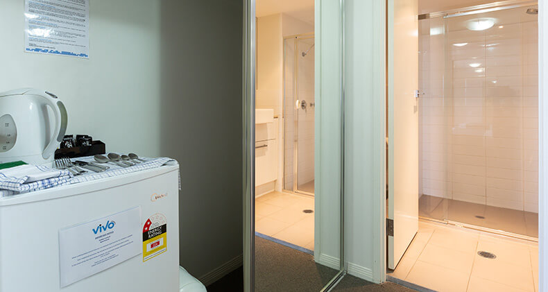 gabba-central-hotel-room-room-to-bathroom | Gabba Central Apartments - Brisbane